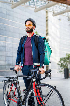 Food delivery service, rider delivering food to clints with bicycle - Concepts about transportation, food delivery and technology