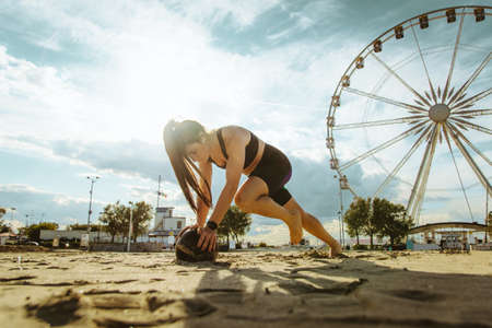 Functional training workout on the beach, fit and athletic woman doing sport outdoors - Concepts about lifestyle, sport and healthy lifestyle Archivio Fotografico - 159472345