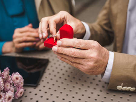 Beautiful senior couple dating outdoors - Mature couple celebrating marrige proposal, concepts about elderly and lifestyle