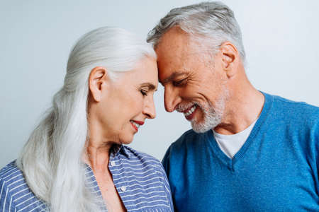 Happy senior couple posing in a studio for a photoshooting. concept about lifetsyle and seniority