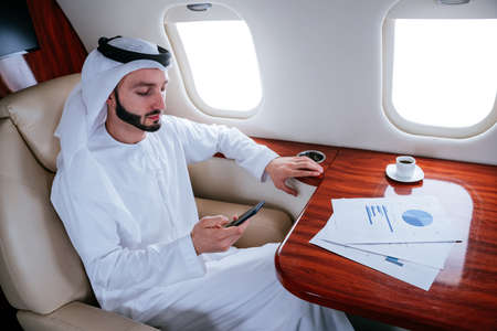 Business man from united arab emirates flying on his private jet to Dubai