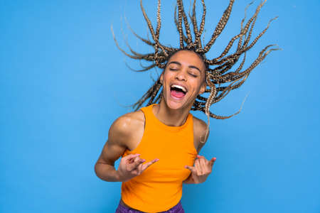 Beautiful afroamerican woman with pigtails portrait on colored background Archivio Fotografico - 161990438