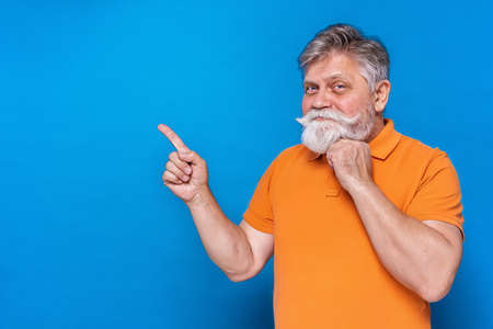 Eccentric senior man with funny expression portrait on background - Active and youthful old male Archivio Fotografico - 161990562