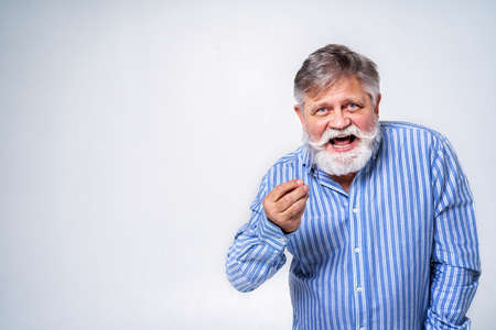 Eccentric senior man with funny expression portrait on background - Active and youthful old male