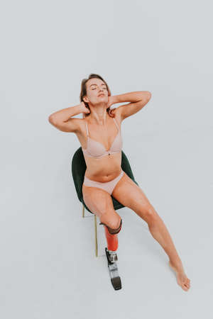 Beautiful young woman with amputation - Pretty and confident woman with leg disability, amputee posing against body shaming