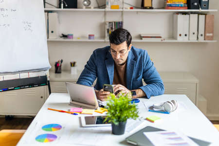 Business company employee working at desk - Entrepreneur with colored smart casual clothes working alone in a start-up office