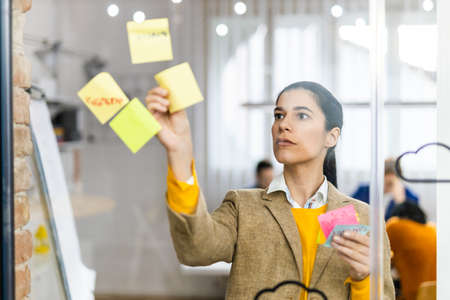 Business company employee brainstorming new ideas for marketing plan - Entrepreneur with colored smart casual clothes working alone in a start-up office