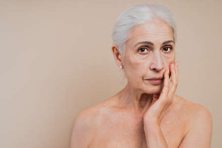 Beautiful senior woman with young and clean look, beauty shot - Pretty senior lady over 60 with perfect skin, concepts about elderly, beauty treatment and skin care