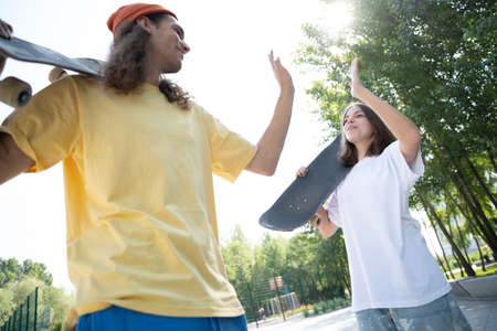 Professional skateboarders having fun at the skate park Banque d'images