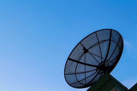 Satellite dish against the blue sky photo