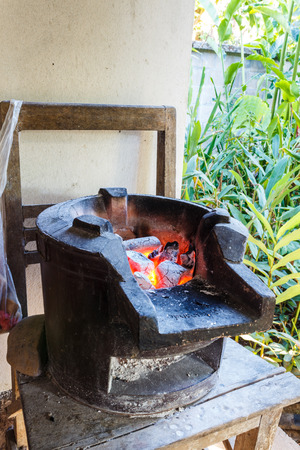 An ancient thai  stove with charcoal fire photo
