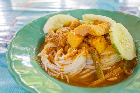 Thai white vermicelli eat with Fish organs sour soup. This is Southern Thai food  style Stock Photo - 28647738