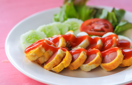 Sausage egg roll with chilli sauce photo