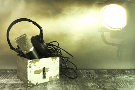 A microphone and headphones in an old drawer. Stok Fotoğraf