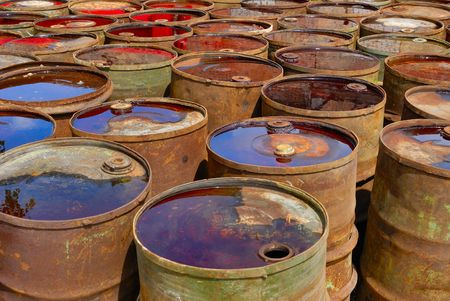 Empty rusting toxic chemical barrels  photo