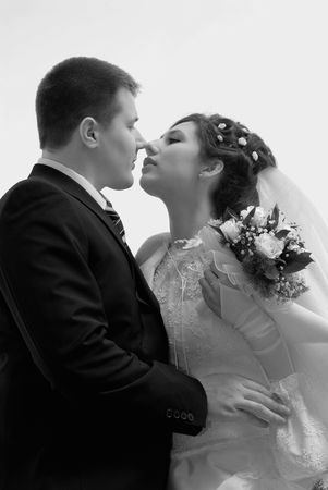 Just married. First tender kiss. BW Stock Photo