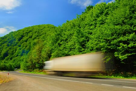 High speed heavy truck on the road. Motion blur Stock Photo
