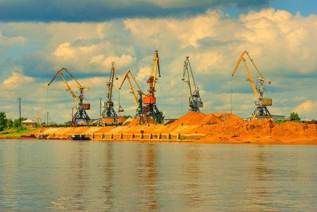 Heavy working harbor cranes Stock Photo