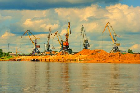 Heavy working harbor cranes Stock Photo