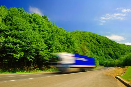 Heavy truck on the road. Motion blur Stock Photo