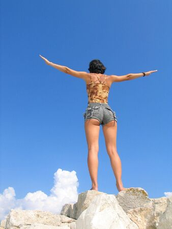 Young girl against deep blue sky