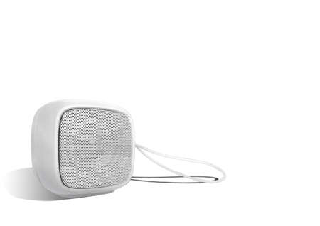 Mini wireless speaker with lanyard isolated on white color background. Rounded square shape.
