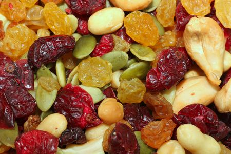A background of Cranberry Trail Mix containing nuts, raisens, cranberries, pumpkin seeds and more. Stock Photo