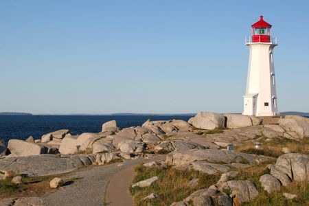 The pathway leading amoungst the rocks to Peggys Cove lighthouse in the village of Peggys Cove, Nova Scotia, Canada. photo