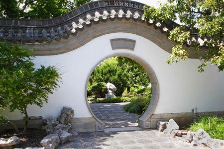 A circular gate to a lush oriental garden. Stock Photo - 3279784