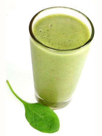A healthy drink containing fruit and vegetable juices as well as spinach. Imagens