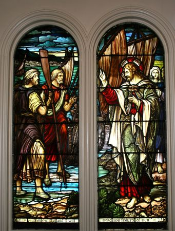 Stained glass windows showing the Biblical story of Jesus and the disciples and the fish.  Circa 1900 Stock Photo - 3298789