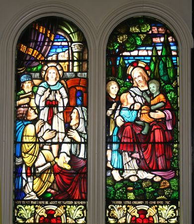 christ the king: Stained glass pictorial of Jesus and the children circa 1900.