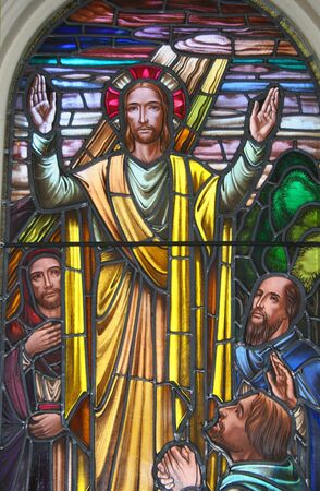 A stained glass pictorial of Jesus offering blessings, circa 1900. photo