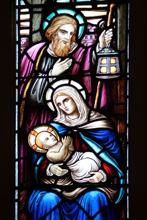 Stained glass window, in 19th century  church, of  Jesus, Mary, and Joseph in the manger. Stock Photo - 3303334