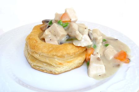 Specialty chicken recipe served on puffed pastry. Stock Photo