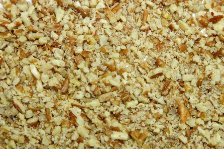 A background of ground pecans used in baking.