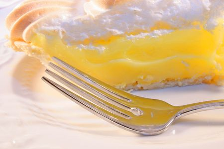 Lemon pie on a plate with fork.