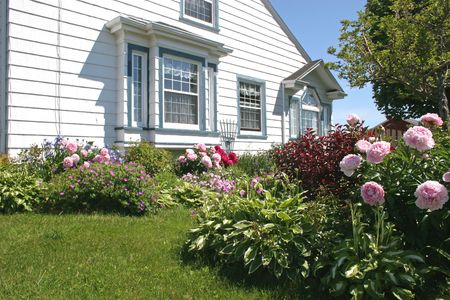 Flower gardens on the south side of a house.