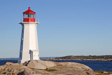 cloudless: Very early in the morning at Peggys Cove Lighthouse, Nova Scotia, Canada.