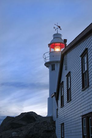 nfld: Lighthouse in Lobster Cove (near Rocky Harbour) in Gros Morne National Park, Newfoundland, Canada. Stock Photo