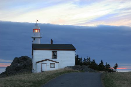 maritimes: Lighthouse in Lobster Cove (near Rocky Harbour) in Gros Morne National Park, Newfoundland, Canada. Stock Photo