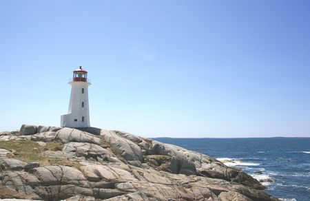 Rocks, ocean and lighthouse at Peggys Cove, Nova Scotia. photo