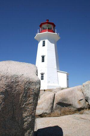Rocks and lighthouse at Peggys Cove, Nova Scotia. photo