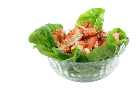 One pound of cooked lobster meat, claws and tails,  in a glass bowl lined with lettuce. photo