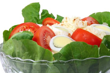 A bowl of potato salad with tomato wedges and sliced eggs. Stock Photo