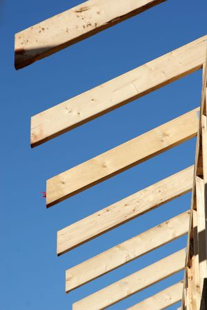 rafters: The ends of wooden rafters on a new home or building. *Shallow Depth of Field*