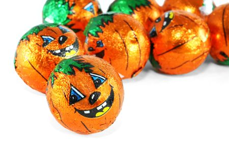 foil: Foil wrapped chocolate Halloween treats with the Jack-O-Lantern motif.