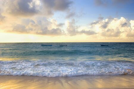 Boats bobbing in the ocean under the sunset of a Barbados beach. Stock Photo - 3899164