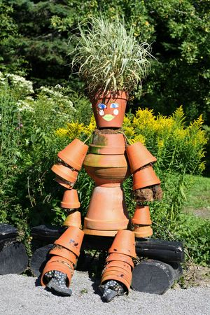 A garden decoration made out of clay plant pots. photo