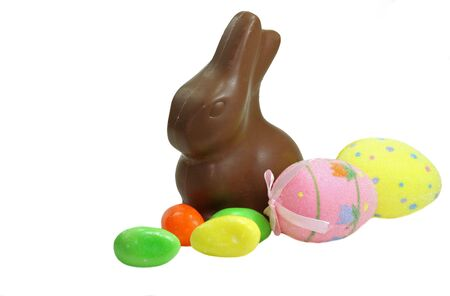 A chocolate Easter bunny, some Easter candy eggs and some Easter decorations. Stock Photo - 4223093